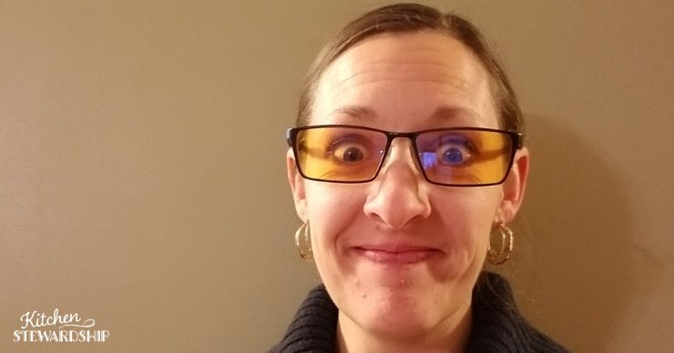 Katie Kimball wearing blue blocker glasses to improve her sleep.
