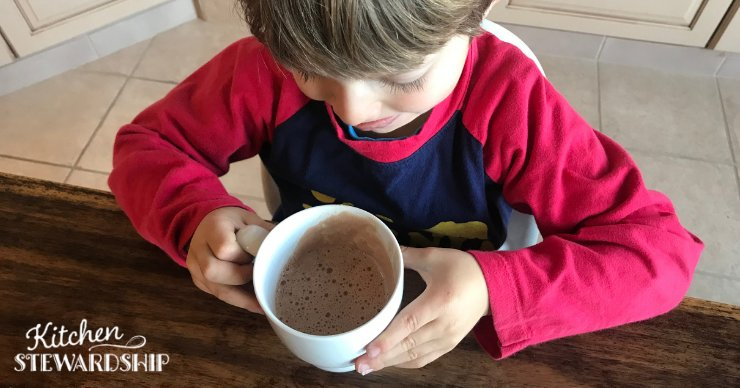 young boy drinking hot chocolate made healthy with gelatin