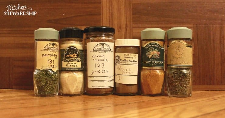 Bulk herbs and spices stored in reused glass jars