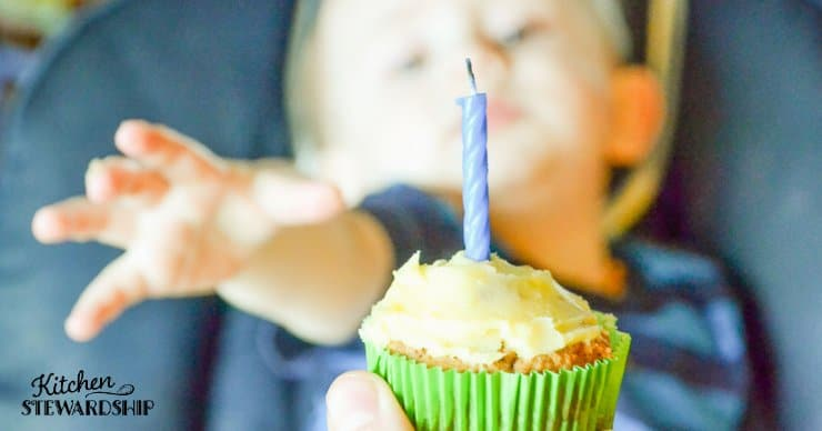 boy reaching for cupcake