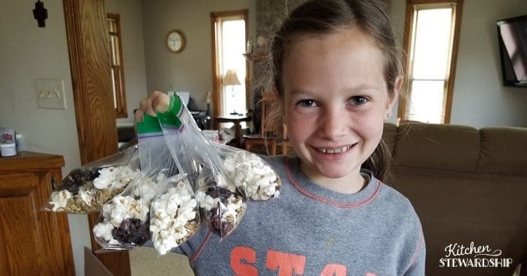 Leah holding trail mix packs