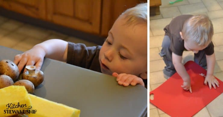 Toddler playing with mushrooms and a cutting board