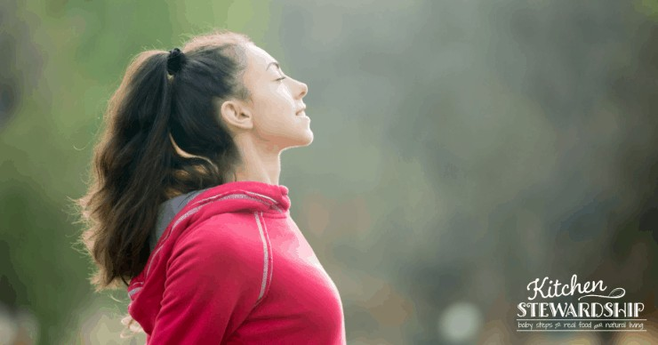 woman stretching and breathing