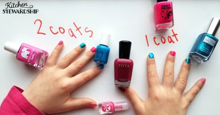 Nail polish bottles with little girl's hands
