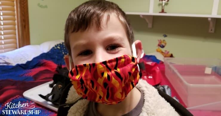Boy in a dust allergy mask