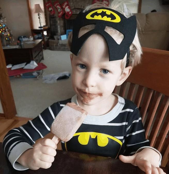 little boy wearing Batman mask, healthy birthday treats
