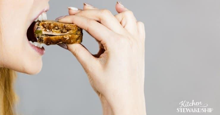 woman taking a bite
