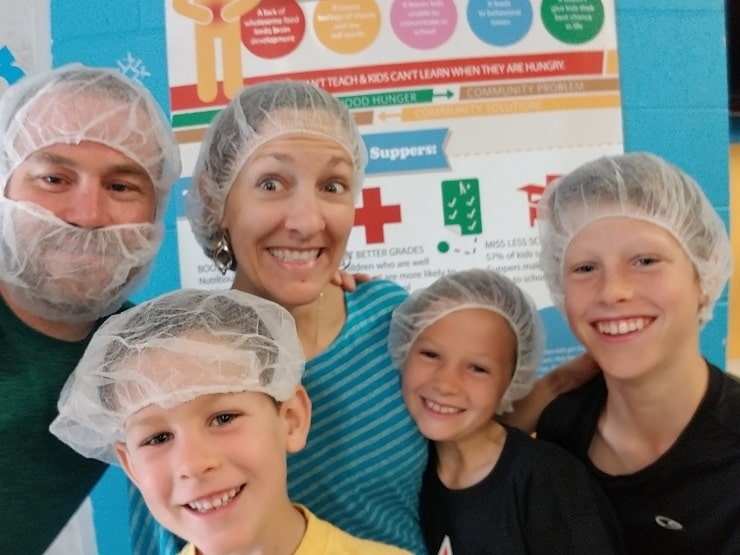 family volunteering at Kids Food Basket, birthday celebration ideas