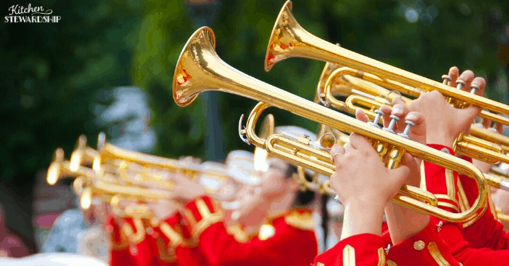 horns and men in red uniforms