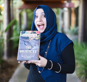 Dr. Madiha Saeed holding her book, The Holistic RX