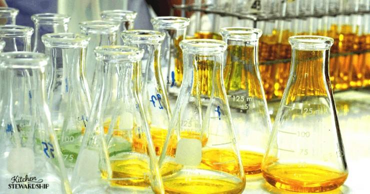 chemistry flasks measuring golden liquid
