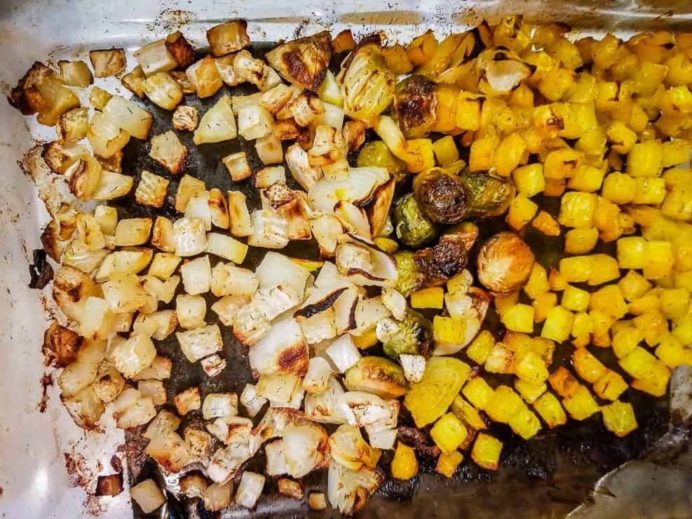 dill roasted mixed vegetables - golden beets, turnips, Brussels sprouts, onions in glass dish
