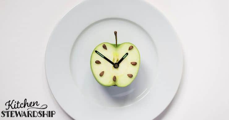 apple clock on a plate