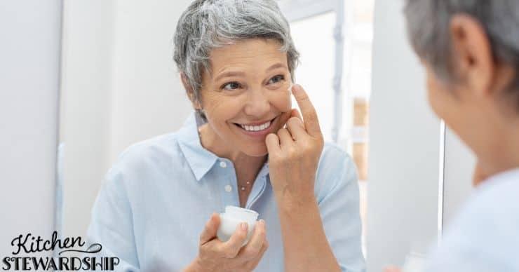 Woman using face moisturizer