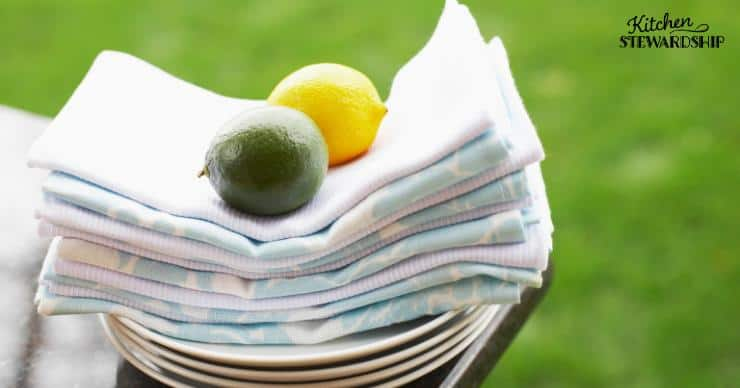 Stock of reusable cloth napkins with a lime and lemon on top