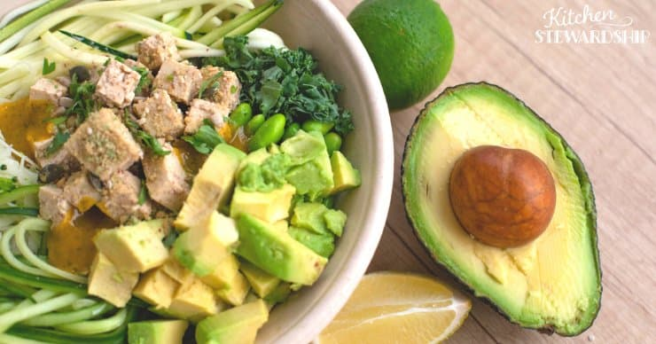 A nutrient dense meal or snack of zoodles, avocado, tuna, and other vegetables.