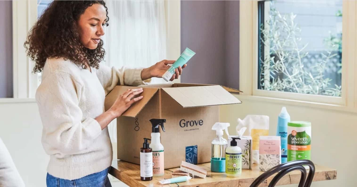 woman unboxing box from grove collaborative
