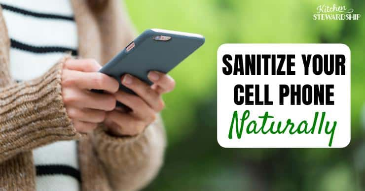 A woman holding her cell phone - Sanitize your cell phone naturally