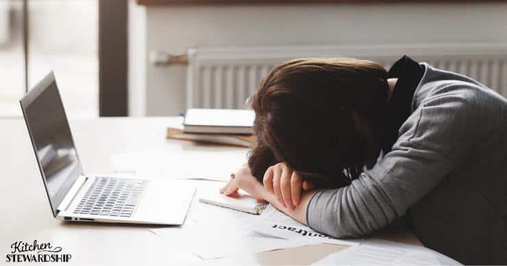Sleep deprived woman asleep at laptop