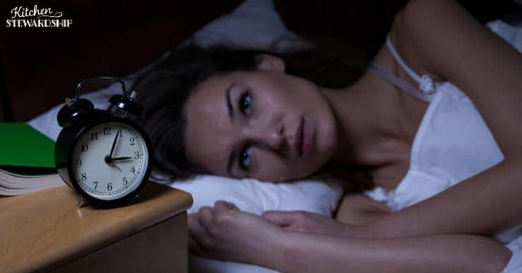 Woman with insomnia awake at 3am