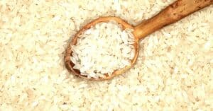 wooden spoon on a bed of brown rice