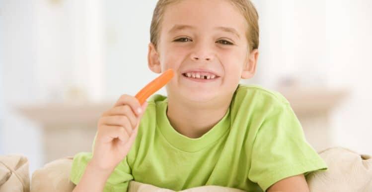 boy eating a carrot stick