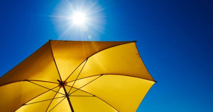 sunshine on yellow umbrella