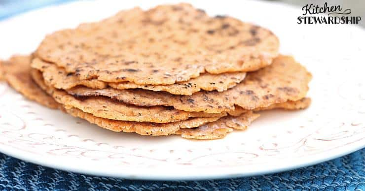 Grain-free keto tortillas stacked on a plate made with the homemade keto tortillas recipe