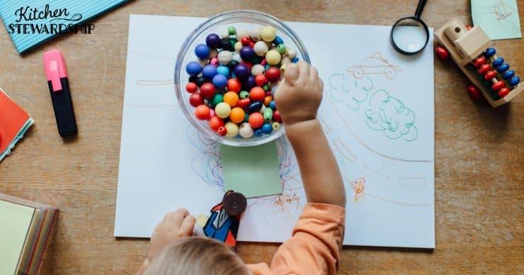 child sorting beads