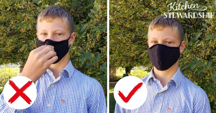 teen adjusting face mask incorrectly