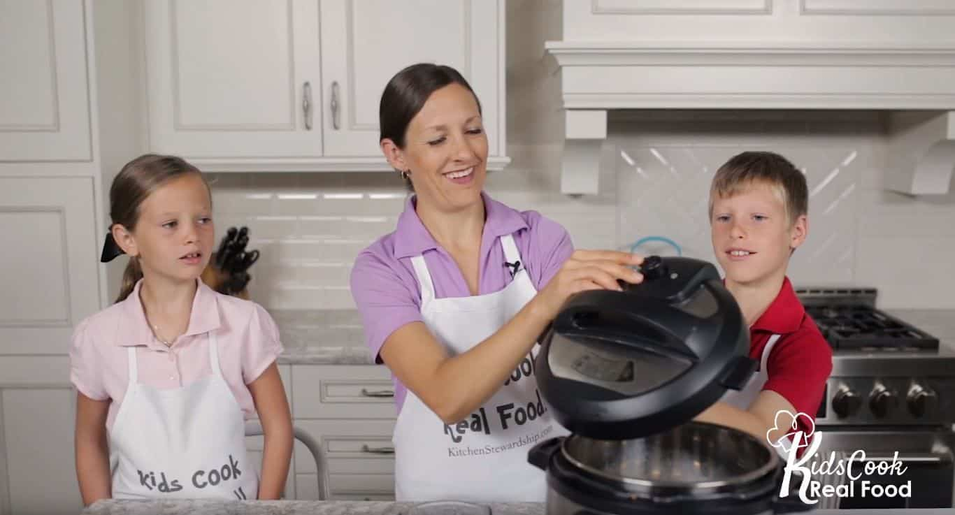Katie Kimball teaching kids about Instant Pot lid