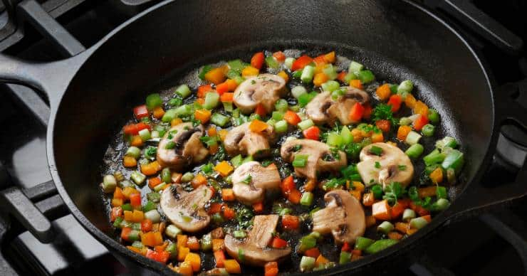 Vegetables sauteed in a cast iron pan