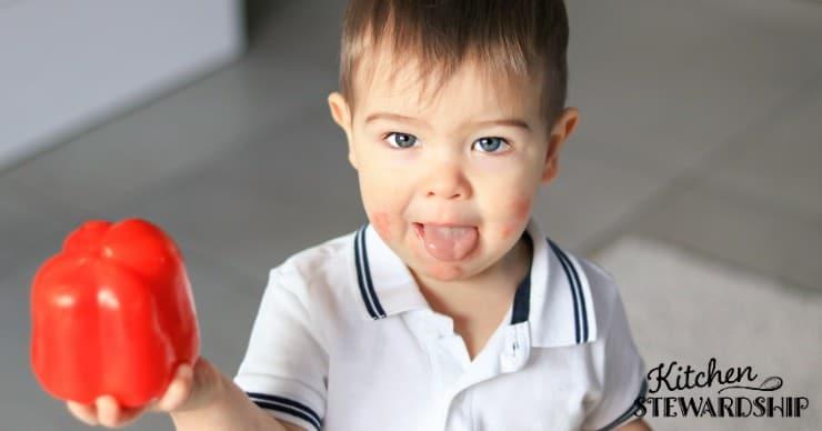 boy holding a pepper