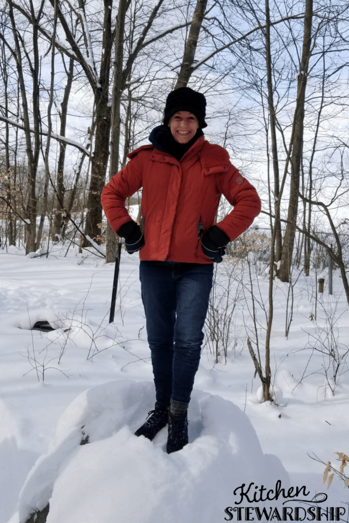 Katie standing on a snow pile